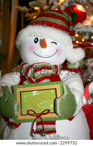 Snowman with Red, White, and Green Scarf, Hat, and Gloves