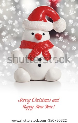 Snowman with Santa Hat. Christmas greeting card with snowflakes - stock photo