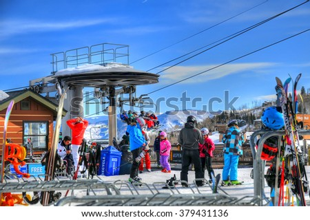 SNOWMASS, ASPEN, FEB 13: Tourists are getting ready for skiing Ski resort in Snowmass near Aspen Colorado on a sunny day in Aspen, CO, Feb 13, 2016 - stock photo