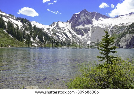 Snowmass Lake and flanks of Snowmass Mountain, Colorado 14er, Rocky Mountains - stock photo