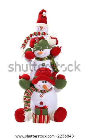 Snowmen family stacked on each others shoulders - stock photo