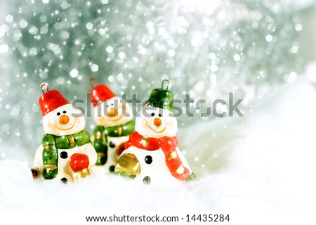 Snowmen on a cold winter with snowflake - Christmas decoration - stock photo