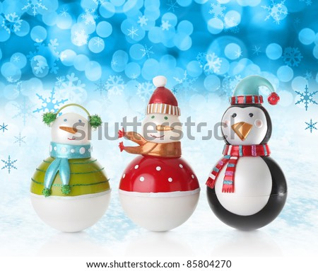Snowmen on a festive Christmas snow background. - stock photo
