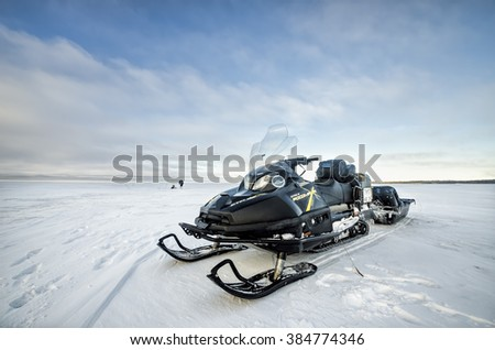Snowmobile on the background of the winter sea. Russia, Arkhangelsk region, the White Sea. February 2016