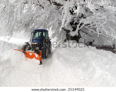 snowplough on the extremely frozen mountain road - stock photo