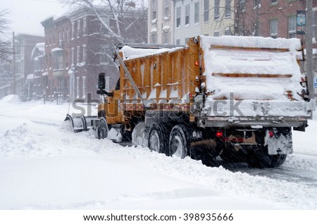 Snowplow Clearing the Streets of Harrisburg, Pennsylvania - stock photo