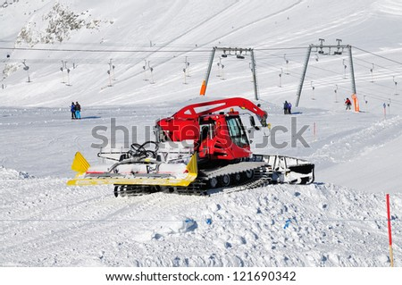snowplow working on a ski slope in Hintertux Zillertal, Austria