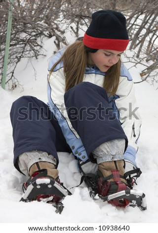 Snowshoe Girl - stock photo