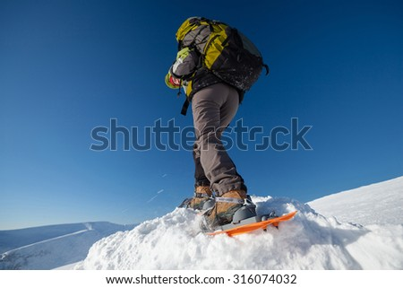 Snowshoeing in Carpathian mountains in wintertime - stock photo