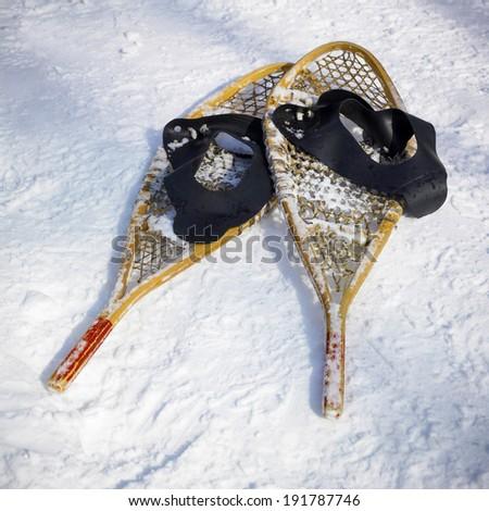 Snowshoes in snow, Orangeville, Dufferin County, Ontario, Canada - stock photo