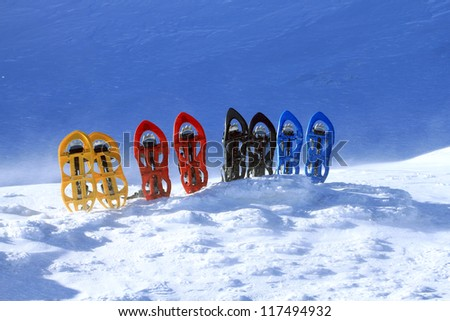 Snowshoes standing in the snow. - stock photo