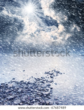 Snowstorm and beautiful landscape with the river - stock photo