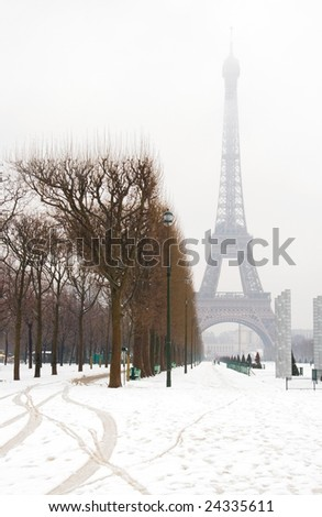 Snowy day in Paris - misty Eiffel Tower and lots of snow - stock photo