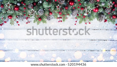 Snowy Fir Branches With Christmas Ornament On Table