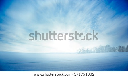 Snowy Landscape with Field and Rising Sun. Copy Space. Beautiful Winter Background. - stock photo