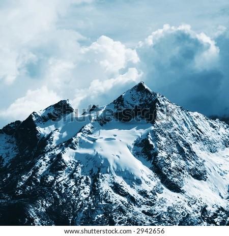 Snowy mountain peak - stock photo