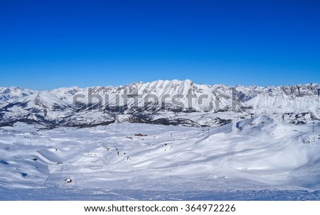 Snowy mountain ridge in the French Alps in wintertime - stock photo