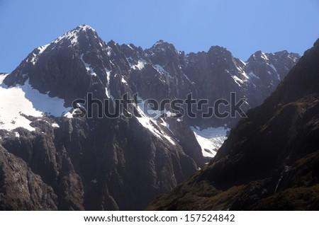 Snowy mountain ridge, New Zealand - stock photo