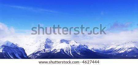 Snowy mountain ridges at Lake Louise ski resort in Canadian Rockies, panoramic view - stock photo