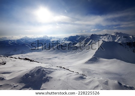 Snowy mountains and view on off-piste slope. Caucasus Mountains, Georgia, ski resort Gudauri. Wide angle view. - stock photo