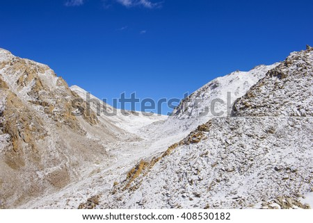 Snowy mountains at sun day - stock photo
