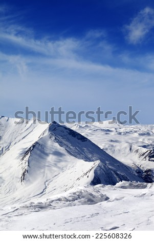Snowy mountains at sunny day. Caucasus Mountains, Georgia, ski resort Gudauri. - stock photo