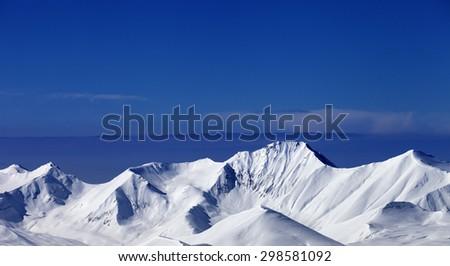 Snowy mountains at sunny day. Caucasus Mountains, Georgia, ski resort Gudauri .Panoramic view - stock photo