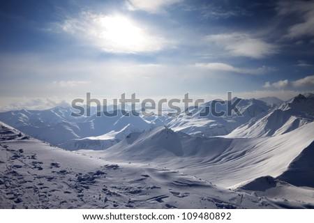Snowy mountains in evening. Caucasus Mountains, Georgia, ski resort Gudauri. - stock photo