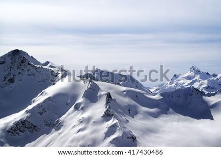 Snowy mountains in evening. Elbrus region, Caucasus Mountains. - stock photo