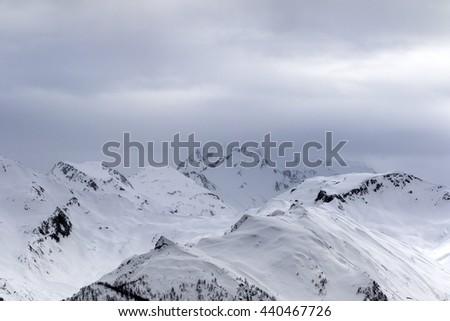 Snowy mountains in fog at gray morning. Caucasus Mountains. Svaneti region of Georgia. - stock photo