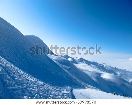 Snowy mountains in ski area - stock photo