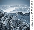 Snowy mountains in the Swiss Alps. View from Mount Titlis, Switzerland. - stock
