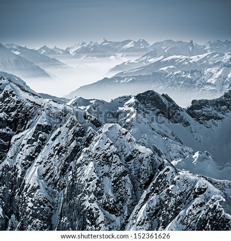 Snowy mountains in the Swiss Alps. View from Mount Titlis, Switzerland. - stock photo