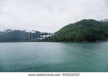 Snowy mountains off the icy waters of Alaska - stock photo