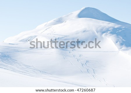 Snowy mountains showing ski tracks - German Alps