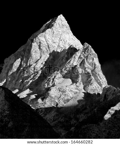 Snowy peak on the background of blue sky in the morning (view from Tengboche monastery) - Nepal, Himalayas (black and white) - stock photo