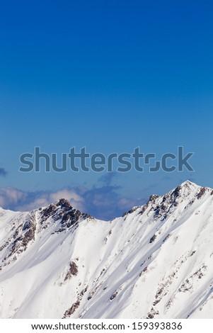 snowy peaks against the blue sky, Austria - stock photo
