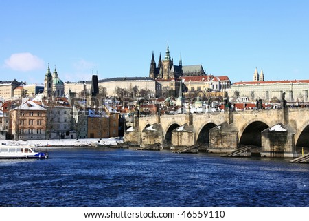 Snowy Prague gothic Castle on the River Vltava with Charles Bridge
