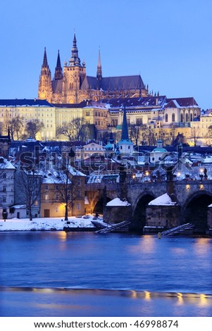Snowy Prague gothic Castle with Charles Bridge in the Night