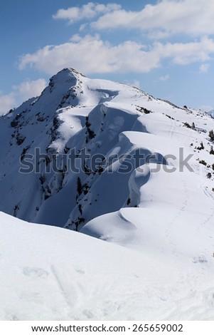Snowy ridge to Rippetegg peak, Austria - stock photo