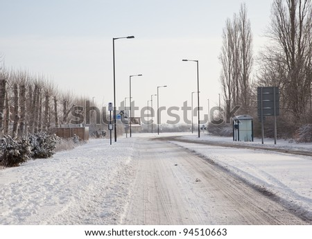 Snowy road in winter - stock photo