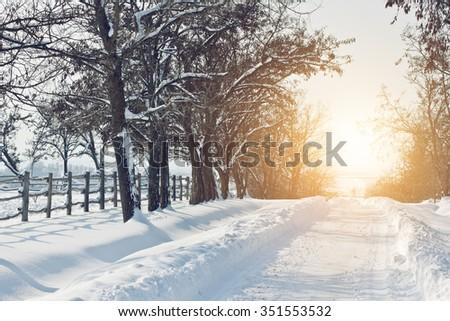 Snowy road sunset - stock photo