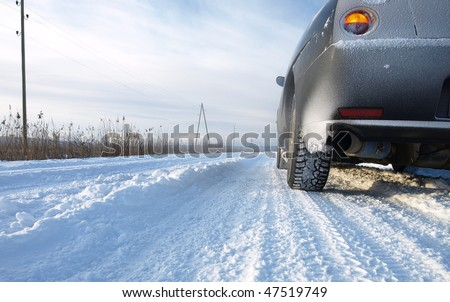 Snowy road surface from the back of unrecognizable car - stock photo