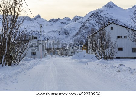 Snowy road through the township of Mefjordvaer on Senja Island, Troms county, Norway