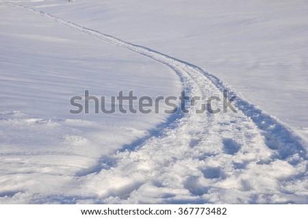 snowy road vanishing away  - stock photo