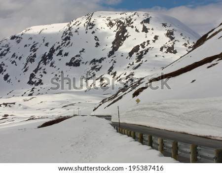 Snowy roads on the way to Geiranger, Norway - stock photo