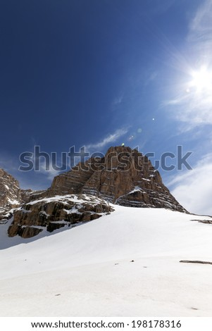 Snowy rocks at nice day. Turkey, Central Taurus Mountains, Aladaglar (Anti Taurus), plateau Edigel (Yedi Goller). Wide angle view. - stock photo