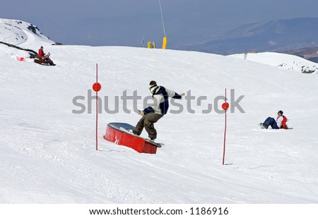 Snowy ski slopes of Pradollano ski resort in the Sierra Nevada mountains in Spain with people skiing and snowboarding - stock photo