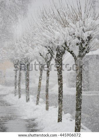 snowy street city - stock photo