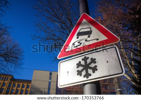 snowy street sign in germany - stock photo